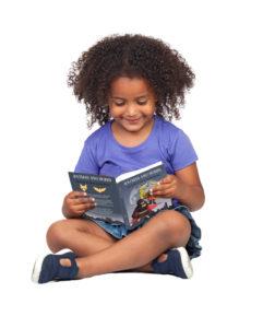 child reading ratman and robin
