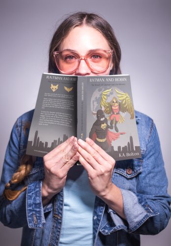 Woman Reading Ratman and Robin